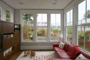 Living Room With Fireplace And Windows by How To Decorate A Living Room With Large Windows