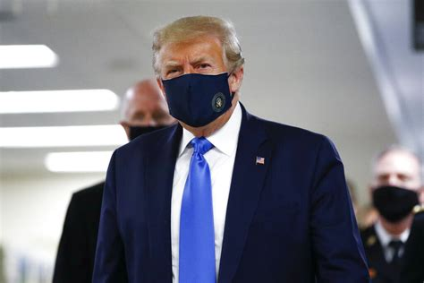 Trump wears mask publicly for first time during visit to