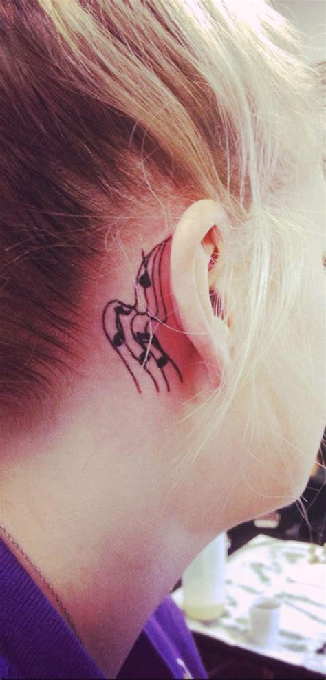 note tattoo   ear tattoos