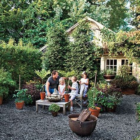 gravel courtyard graveled courtyard backyard beauty on a budget outdoor living backyards and living rooms