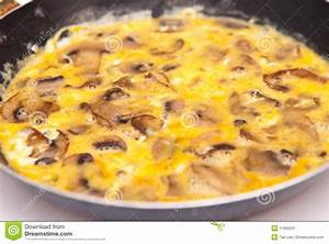 Scrambled Eggs With Mushrooms On Frying Pan Stock Image ...
