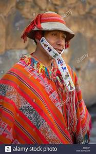 man in traditional costume with poncho, Ollantaytambo ...