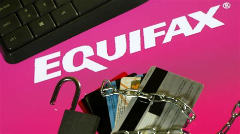 What credit cards use equifax. Credit cards, a chain and an open padlock is seen in front of displayed Equifax logo in this ...