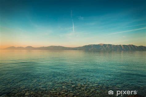 peaceful landscape  sea  hills  sunrise wall