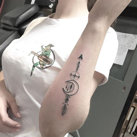 stylized arrow  crescent moon tattoo tattoogridnet