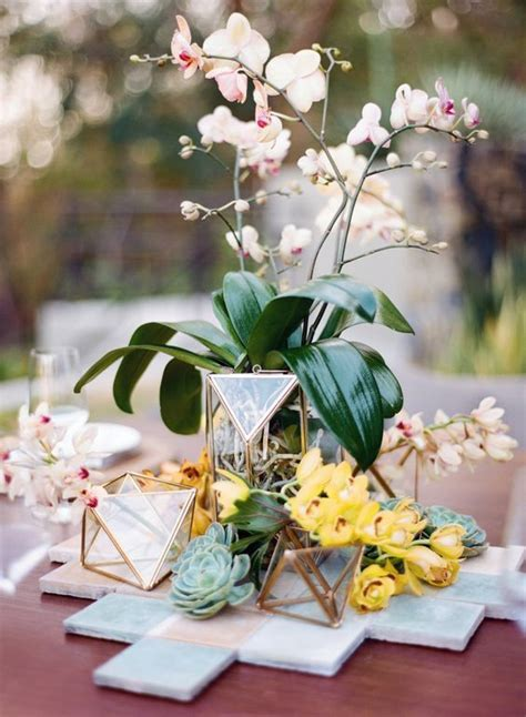 lush  bold tropical wedding centerpieces weddingomania