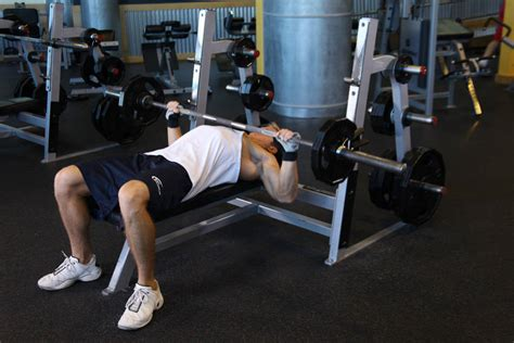 Barbell Flat Bench by Wide Grip Barbell Bench Press Exercise Guide And Video