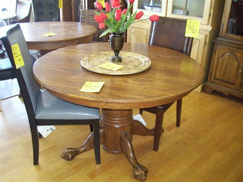 brown wooden table with cylinder base and four legs
