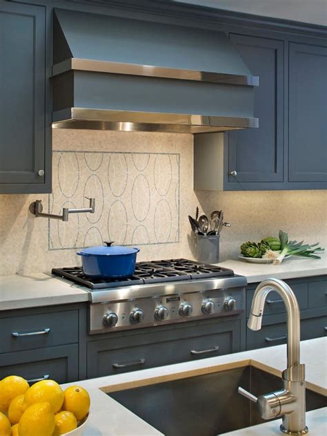 chrome backsplash the custom hood with chrome straps and the honed backsplash from artistic tile makes the cooktop