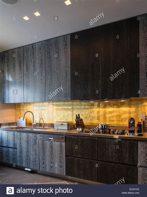 Gold leaf backsplash in kitchen with dark smoky oak
