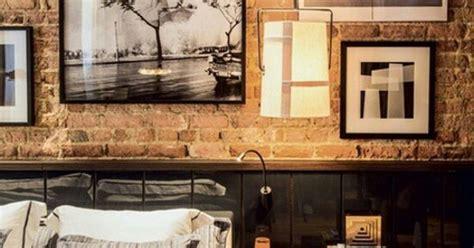 loft bedroom features black wainscoting exposed