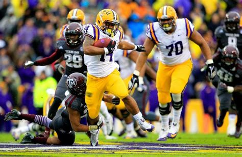 Running Back Terrence Magee #14 of the LSU Tigers rushes ...