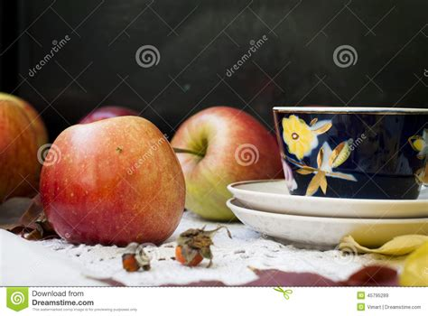 how many apples in a cup red fresh apples with leaves and cups for tea stock photo