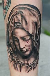 Virgin Mary Bleeding Eye Catholic Tattoo On Sleeve
