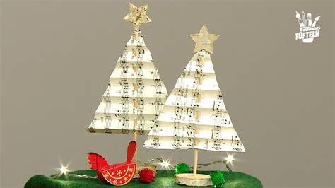 diy weihnachtsdeko tannenbaeume aus notenpapier basteln lifestyle bildde