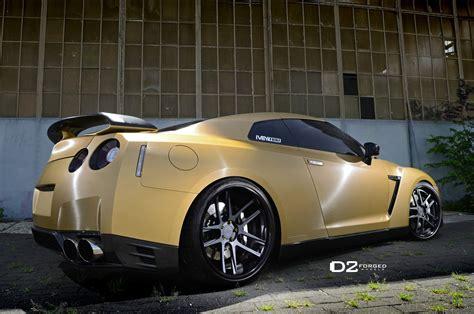 nissan gtr matte black gold matte gold nissan gtr d2forged cv8 wheels three quarter