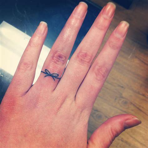 girly word finger tattoos