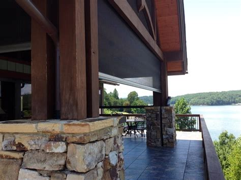 retractable screens at lake house with folding wall