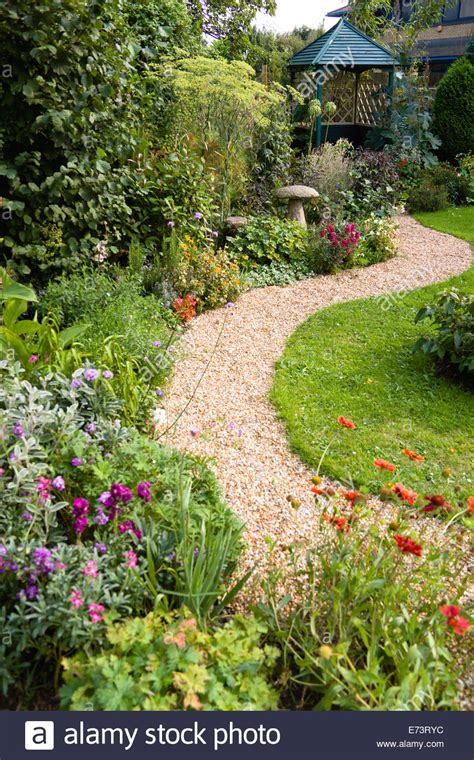 English cottage garden, winding shingle path leading to a