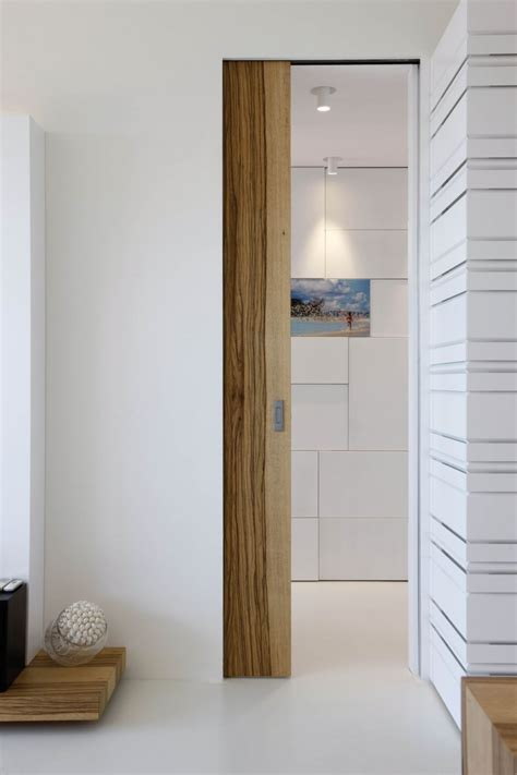 Sliding Door For Small Bathroom by Secret Doors And Unusual Interiors Define This Seafront House