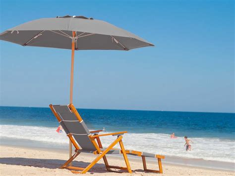 cing chair with footrest and umbrella frankford umbrellas wooden lounge chair with
