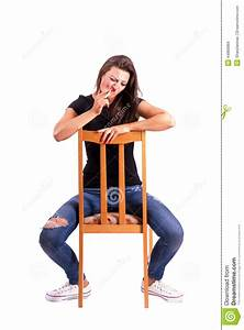 Woman Sitting Backwards On The Chair Smoking Cigarette ...