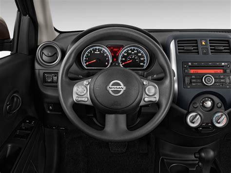 image  nissan versa  door sedan cvt  sv steering