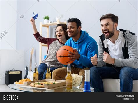 type of sport that fans watch on tv on thanksgiving basketball fans home cheerful image photo bigstock