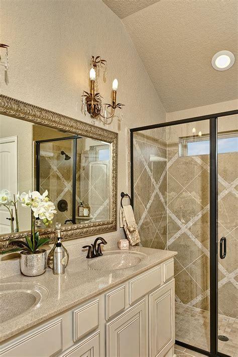 gehan homes cream granite brushed gold mirror tile