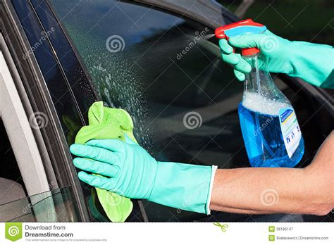 Young Man Washing His Car Window Royalty Free Clipart