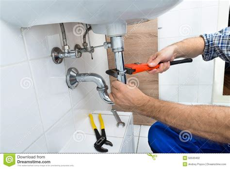 fixing a kitchen sink plumber fixing sink in bathroom stock photo image 7221