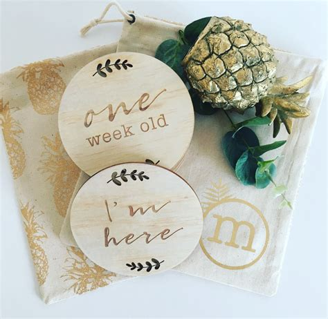 Known for her clean, monochromatic designs with strong graphical shapes and romantic lettering; Months Baby Milestone Cards lasercut timber Wooden