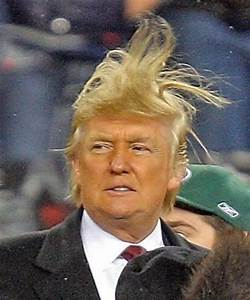 United States President Donald Trump Battles The Wind And The Makeup Line    Pics