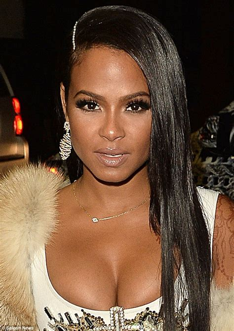 Christina Milian highlights her sizable charms in plunging ...