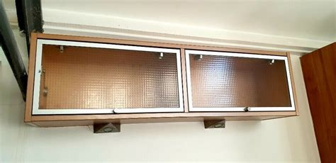 double horizontal wall unit cabinet kitchen glass fronted  hinged doors  spotlights