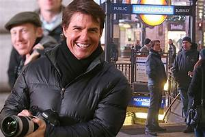 Watch as Tom Cruise has VERY near miss with London bus ...