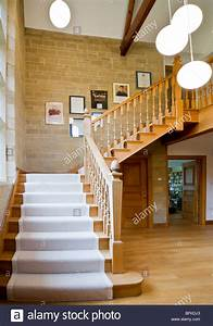 Grand wooden staircase and stone hallway in a grand modern ...