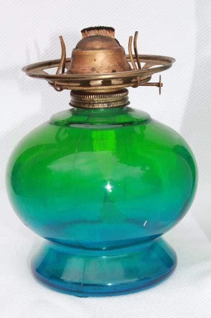 vintage kero oil lamp    wind parlor lamp  blue green tinted glass globe shade