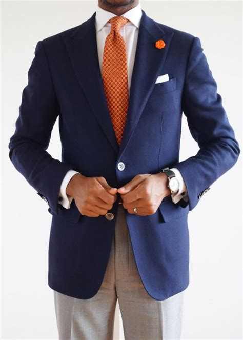 navy blazer white shirt orange tie light grey pants