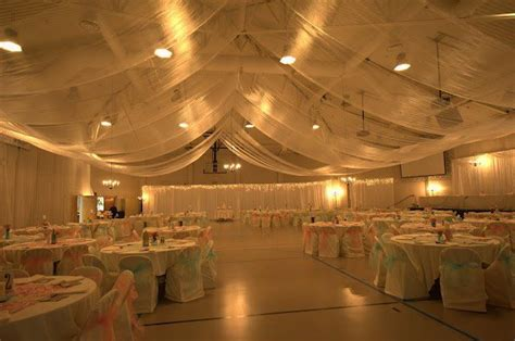how to drape a ceiling for wedding reception from plain gymnasium to wedding reception ceiling