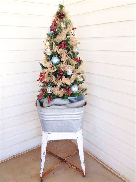 pictures of christmas trees in a wash tub tree in a vintage galvanized wash tub on a country porch decorated with burlap