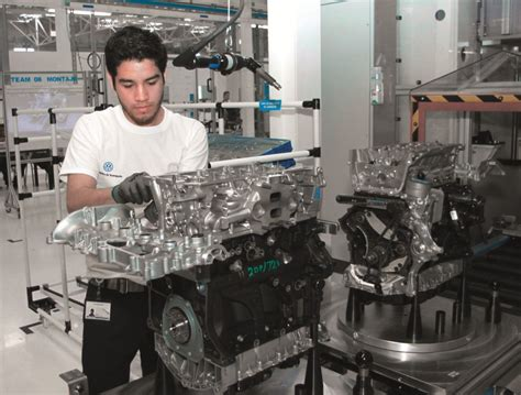 volkswagen mexico plant image technician assembling ea888 engine at volkswagen