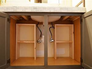 A step by step guide for creating storage under the sink diy for Bathroom cupboard storage solutions