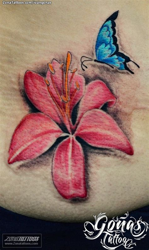 tatuaje de flores orquideas mariposas