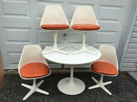 vintage tulip table and four fiberglass chairs with orange