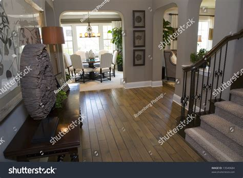 floor and decor stock mansion hallway with a hardwood floor and modern decor stock photo 13540684 shutterstock