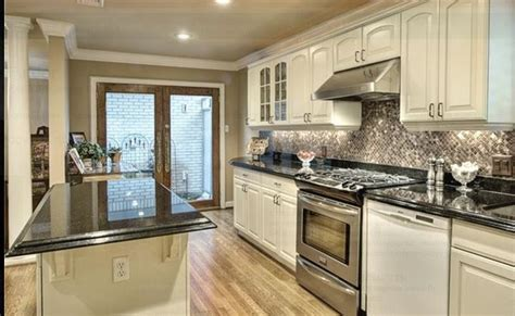 white cabinets with black granite white kitchen with black galaxy granite