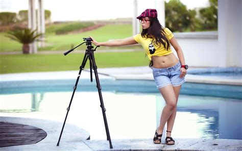 women charmy kaur belly legs shorts jean shorts  shirt psy swimming pool glasses