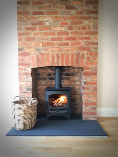 harth fireplace charnwoodc fiverivenslatehearthbrickfireplace jpg 960