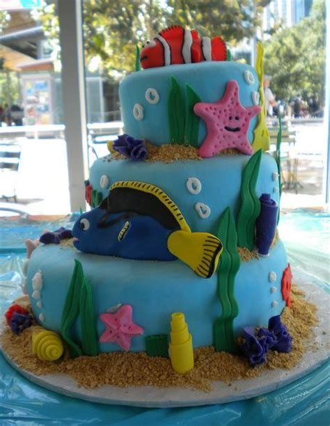 tier ocean theme cake  fish shells sand